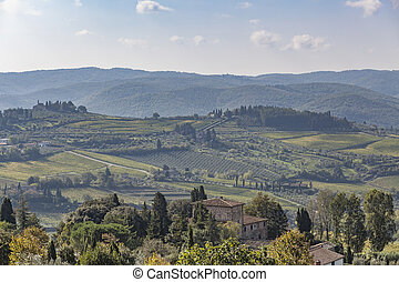 View over old stone house to hills with vineyards near Chastellina in Chianti in Tuscany
