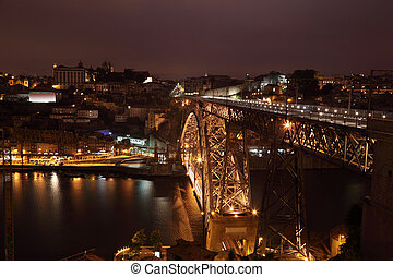 View over the Dom Luis I bridge and Porto at night, Portugal
