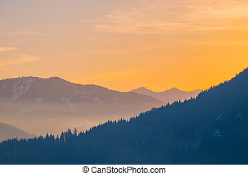 View over valley Ennstal to sunset over mountains Gumpeneck, Hangofen