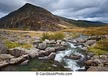 View over waterfall towards Pen-yr-Ole-Wen mountian in...