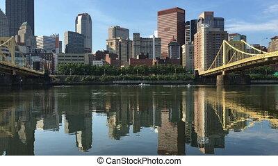 View Pittsburgh skyline between two bridges