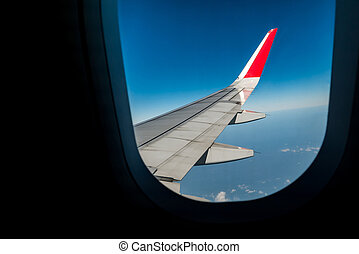 View plane wing from Airplane Window