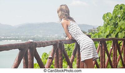 Lady in dress enjoying view from the view point