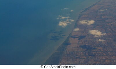 View Rural Seacoast from Airliner Window - panorama of rural...