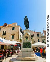 A view of a statue in bronze of Ivan Gundulic , Dubrovnik in Croatia