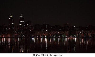 View the city at night across the river