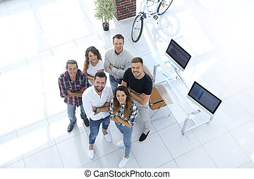 group of creative professionals standing in office