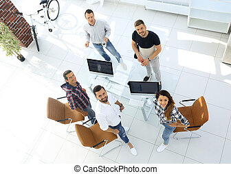 employees of travel agencies standing in office