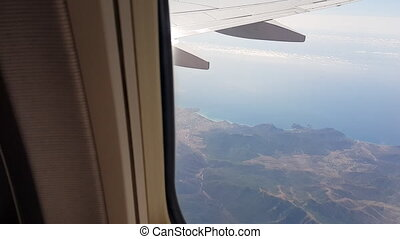 View through a passenger airplane window flying over...