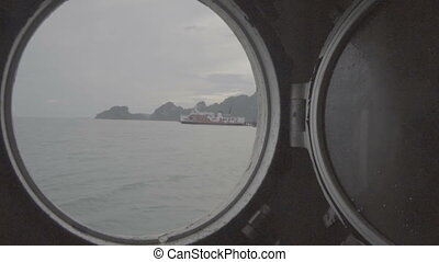 View through a ship's porthole on the sea - Video with view...