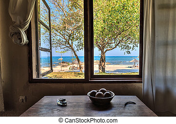View through a window from a house at the beach