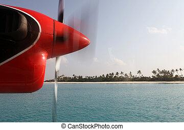 View through air taxi window, Maldives