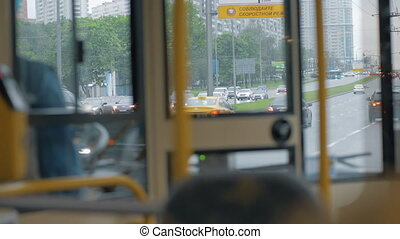View through bus windscreen to car traffic on the road, Moscow