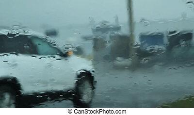 View through rainy windshield.