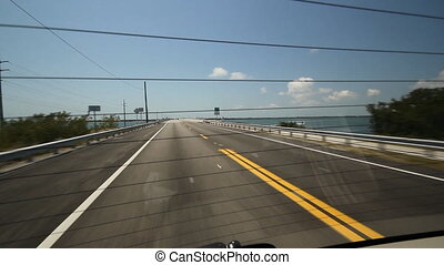 View through rear window. Florida. - Driving on a highway in...