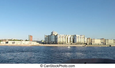 View through the Neva River from the moving car on Maloookhtinskaya Embankment in Krasnogvardeisky district of St. Petersburg. Russia