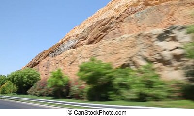 view through window of car moving in Muscat - capital of...