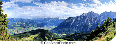 Panorama of the Austrian mountain world from Bavaria in Germany; view in the Salzach Valley with many villages