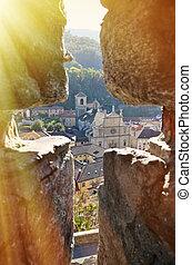 View to Bellinzona town through the ancient arrow-loop
