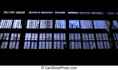 View to blue sky through the windows of old grungy...
