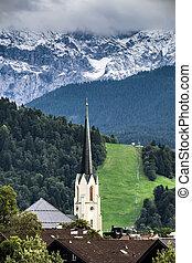 View to church of Garmisch-Partenkirchen in autumn