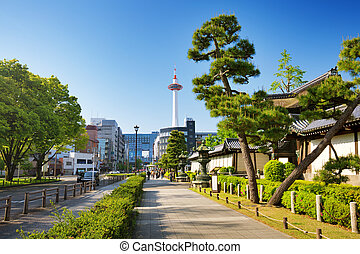 View to Kyoto tower and Kyoto station from a pedestrian way near entrance to Higashi Honganji Temple