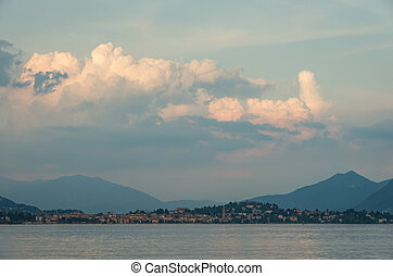 View to Lake Maggiore and Verbania village in sunset. Northern Italy