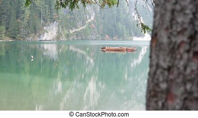 View to lake wooden hut in mountains - View to beautiful...