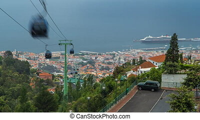 View to ocean with ship over the rooftops with cable car on Madeira timelapse.