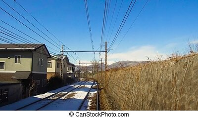 view to suburb from train or railway in japan -...