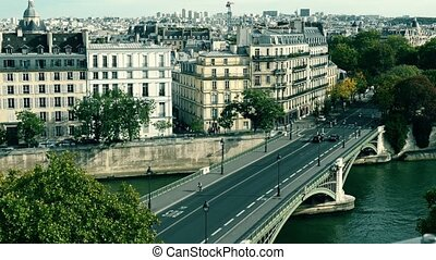 View to the bridge and traditional buildings in Paris,...