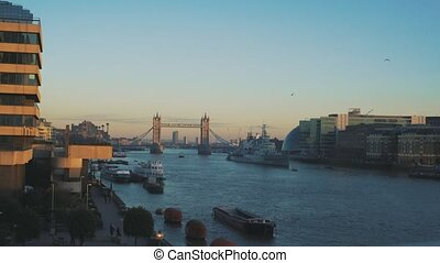 View to the City of London and Tower Bridge. With ships.