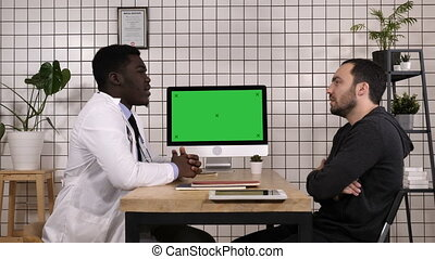 Doctor talking to his male patient. White Display.