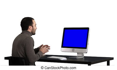 Young business man making video call on his computer, white...
