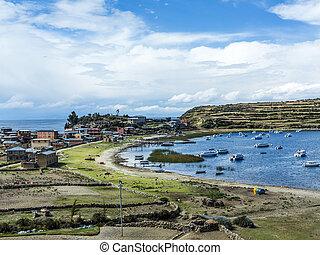 view to Titicaca lake at Isla del Sol with small village Yumani