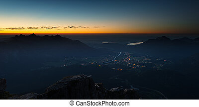 view to valley from austrian mountain at sunrise
