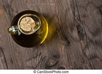 view top of olive oil container bottle with stopper on wood table background