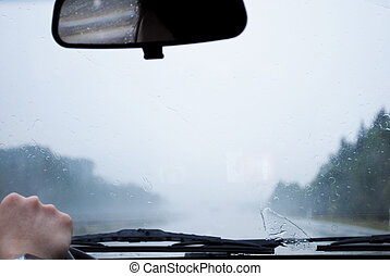 view trough the windshield on motor way with rainy weather