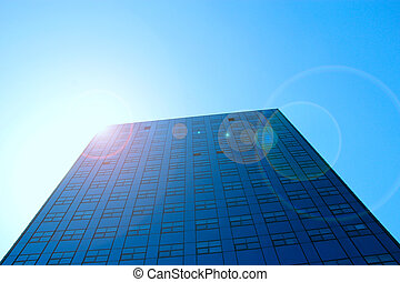 high modern skyscraper with sunlight and blue sky