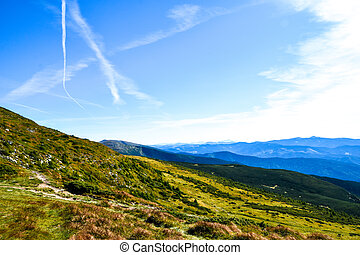 View while climbing Mount Hoverla. View of the mountain, forests and clouds. Ukrainian Carpathians. Blue sky. Nature landscape