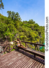 View wooden platform near the blue lagoon in marine national park and girl looking on lake