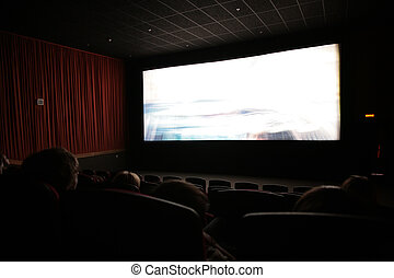 Viewers in cinema, focus on first chairs line