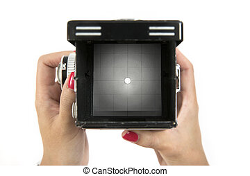 Viewfinder on vintage medium format camera with hand holding