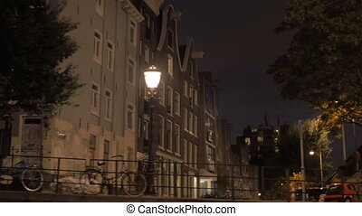 Viewing night Amsterdam from sailing boat