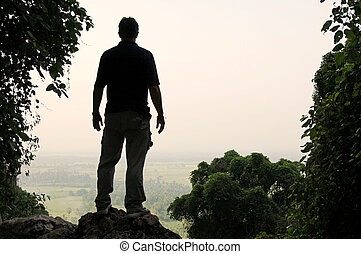 Man's silhouette at a viewpoint overlooking central Thailand