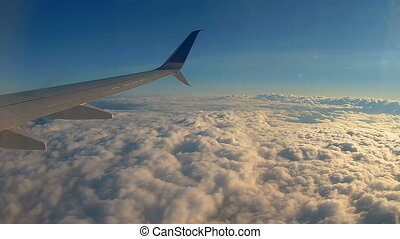 viewpoint Wing of windows airplane flying above the clouds in the sky 4k HD