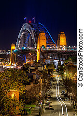Views down the road towards Sydney Harbour Bridge at night -...