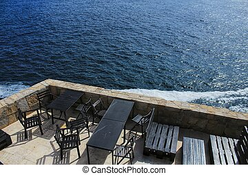 Views from a terrace of the wild Atlantic Ocean with beautiful cliffs in Peniche