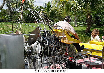 Views from the Everglades - Airboat with driver on a canal...