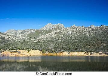Views of La Maliciosa Reservoir, in Guadarrama Mountains...